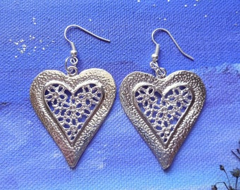 Silver heart dangling earrings
