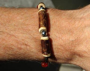 Glass bead and hematite