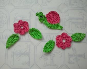 Snail and fushia flowers with leaves crochet cotton