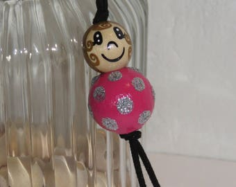 """Keychain doll with wooden beads, bag charm, """"logs smiles"""" fully customizable, and hand painted fuchsia pink color"""