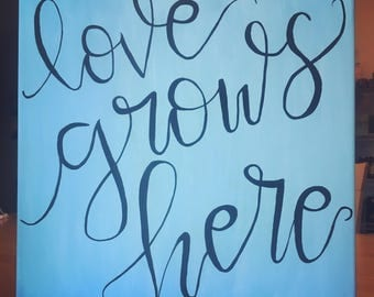 Love Grows Here canvas painting