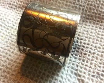 White metal napkin ring.