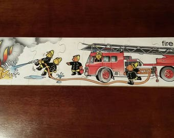 Vintage Educational Jigsaw Puzzle. Complete puzzle Showing a Fire, Fire Engine and Teddy Bear Firefighters. Made of plywood in original box.