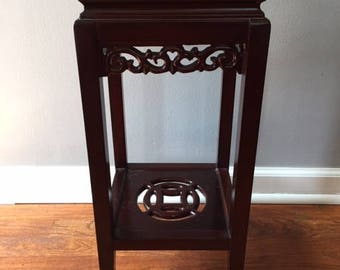 Beautiful carved wood stand with the marble top