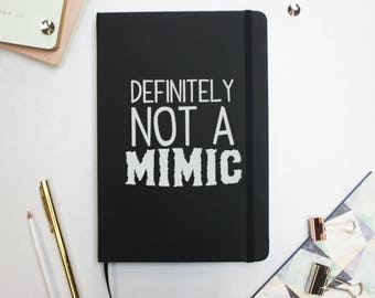 Dungeons and Dragons Not A Mimic Notebook - Mimic DND Hardback Notebook - Black A5 Notebook - DnD Accessories - DM Notebook