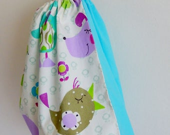 Large laundry bag for child patterns bear, mouse and cheep-cheep on white background, light blue back