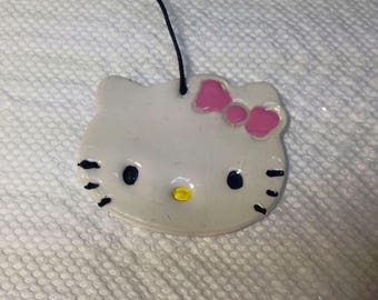 Hello kitty clay ornament.Hello kitty charm.Hello kitty gift tag.Hello kitty party favors