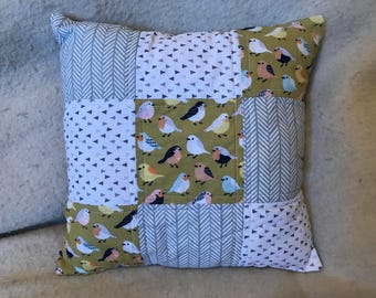 Gold and grey birds and patterns pillow