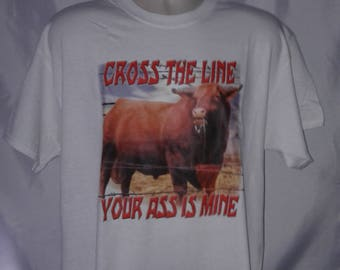 Cross The Line Your Ass Is Mine funny graphic t-shirt