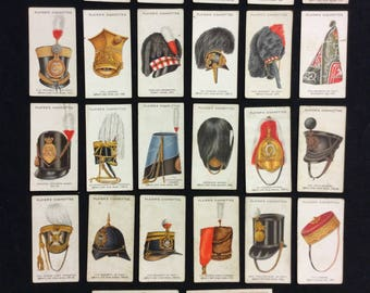 Cigarette cards. Military hats