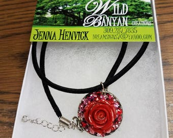 Jeweled necklace pendant with red rose