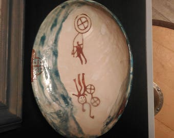 Plates decorated with graphics/sgraffito in stock and to order. Price can vary depending on size and difficulty.