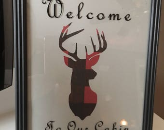 Welcome to our cabin red & black deer head picture