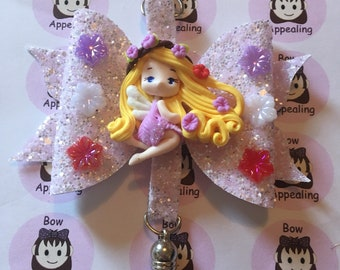 Lilac glitter bow bag charm with girl clay figure, glitter bow, bag charm, for women and girls