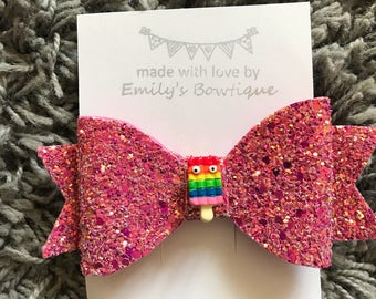 Raspberry pink glitter hair bow with ice lolly character centre