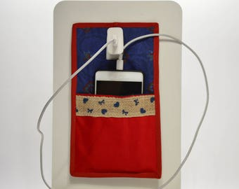Red and blue wall phone holder with Yuta tape
