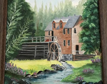 house and waterwheel in summer