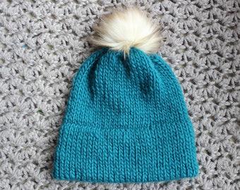 Hand knit double brim beanie with faux fur pom