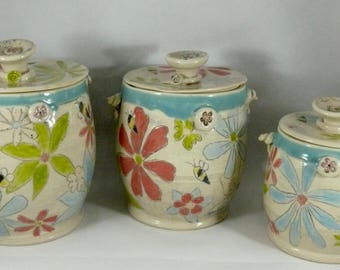 Three Kitchen Ceramic canisters set , cookie jar, coffee canister, lidded jars flour, sugar, coffee, pet food, pasta - lidded storage jar