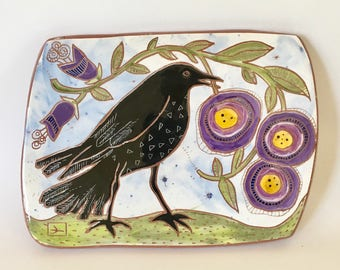 crow and purple flowers hand carved ceramic art tile