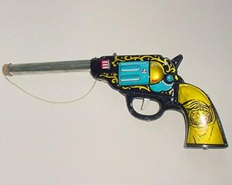 Gun - Tin Cork Shooting Toy Gun  -  30 s or 1940 s  Era - Nice Graphics - A Beauty