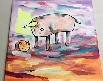 A burrito unicorn and a peapod cat