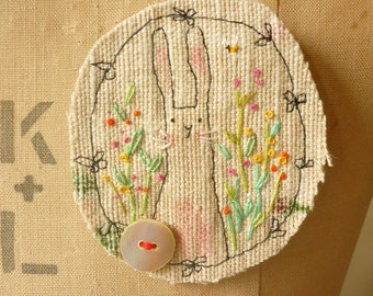 BROOCH Textile - free machine and hand embroidered.  Bunny in the flowers
