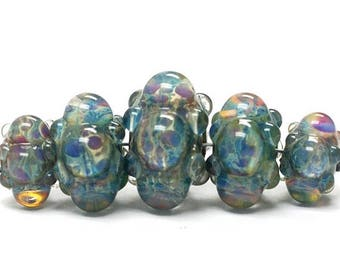 ON SALE 30% off Five Graduated Blue Borosilicate Rondelle Beads Bubbly raised design. - Handmade Glass Lampwork Beads - 10601911