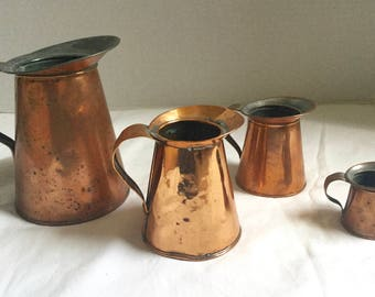 Four Graduated Antique Copper Measures