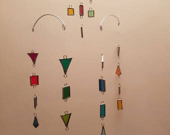 Multicoloured stained glass pieces mobile.