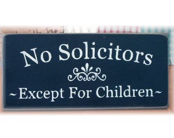 No Solicitors except for children wood sign
