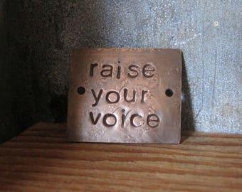 raise your voice - copper passages plaque