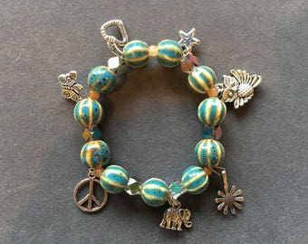 Stretchy Charm Bracelet Made With  Corrugated Round Lampwork Beads