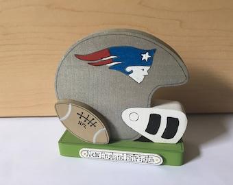 "New  England Patriots football helmet. Handmade, hand painted.measures 4 "" x 4"" , weighs 2.9 oz, 3/4 in wood"