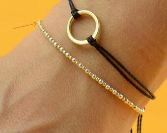 Gold and silver    bracelet . black