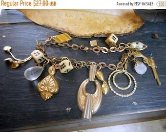 SALE The Casino Moll Charm Bracelet. Upcycled Vintage Trinket and Charm Flapper Victorian Bracelet. Quartz, gun, dice, tiger's eye, bullets