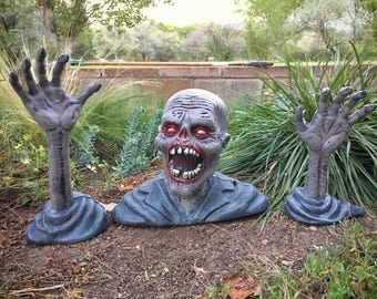 Plastic Zombie emerging from ground decoration, spooky Halloween decor, scary Halloween decorations, Day of the Dead party, zombie decor