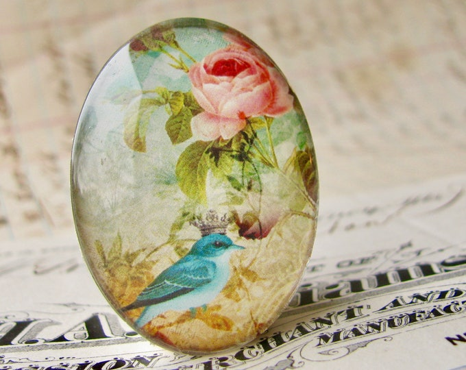 Songbird with crown, from our Beautiful Birds collection of handmade glass cabochons, 40x30mm, oval cabochon, pink roses, aqua blue bird