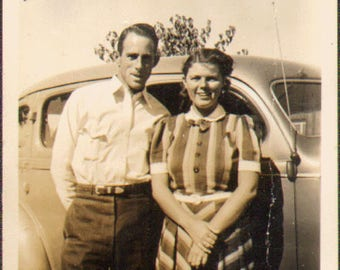Vintage Photo of a Couple Standing Beside a Car