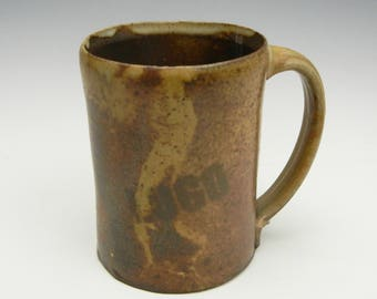 Brown and yellow wood fired LOGO mug