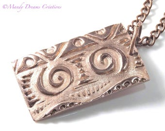 Necklace with modern and unique pendant, in light copper, luminous reliefs, artisan creation