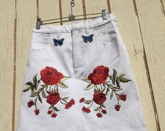 Un worn 80's vintage stretch jeans skirt With NEW embroidery patches