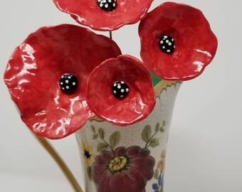 4 decorative ceramic Red POPPY POPPIES with black centers and white polka dots . Handmade and hand painted kiln fired
