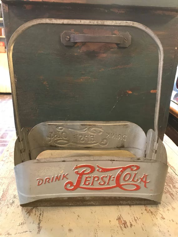 Vintage metal Drink Pepsi Cola Bottle Carrier from country store.