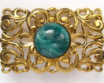 """WESTERN GERMANY signed Brooch.  Gold Plated Openwork Rectangular Pin has Green Marbled Faux Stone Cabochon in Center.  2-3/8""""  W x 1.5""""  H."""