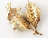 pristine mid century vintage gold tone metal holly leaves brooch by Trafari