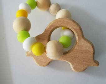 Baby Rattle/Teething Ring with unfinished wood silicone beads and Car. Soothes those sore gums from teeth coming in. Enjoy Everyday Gourmet