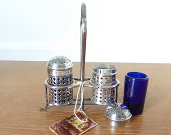 Silver and cobalt blue glass salt and pepper shakers with stand, made in England