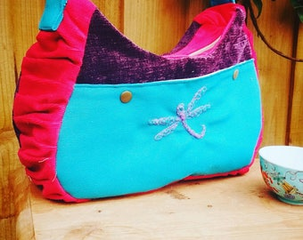 Fabric dragonfly crossbody bag/shoulder bag in a boho shape in bright pink, turquoise + deep purple with zip fastening and adjustable strap