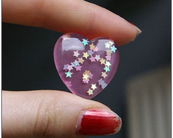 Cabochon resin transparent pink heart with inlaid bright star x 1